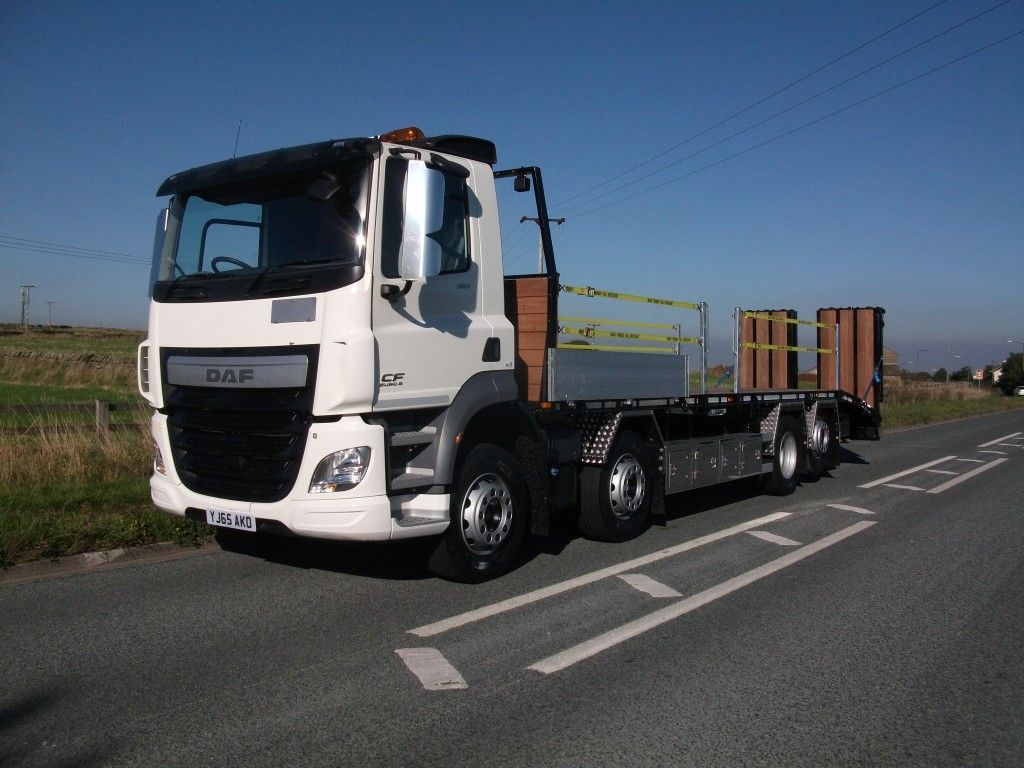 daf rigid beavertail truck parked on the side of a road