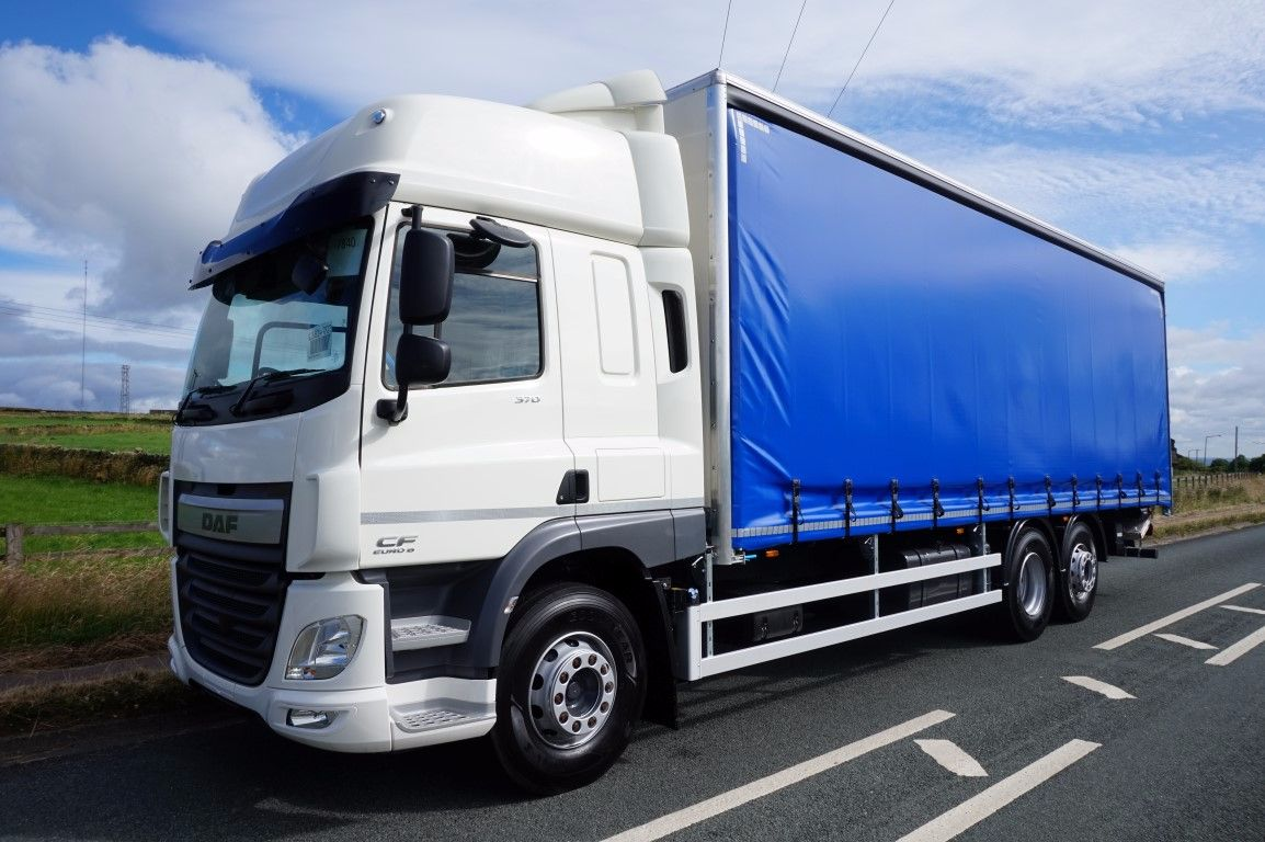 left hand side view of blue daf curtainsider truck