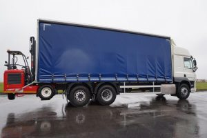 right hand side view of a blue DAF curtainsider