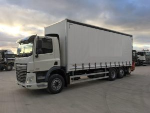left side view of white 2019 daf curtainsider truck