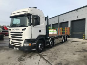 front left side view of Scania 2015 beavertail lorry